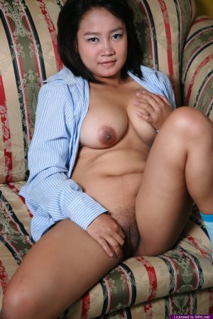 Small Asian woman with saggy tits on her knees showing sex ass