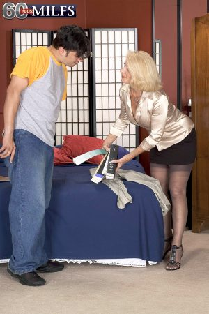 Busty blonde granny Georgette Parks seduces and fucks a younger man