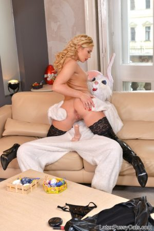 Russian MILF in latex Kayla Green rides a tall bunny's dick on the sofa