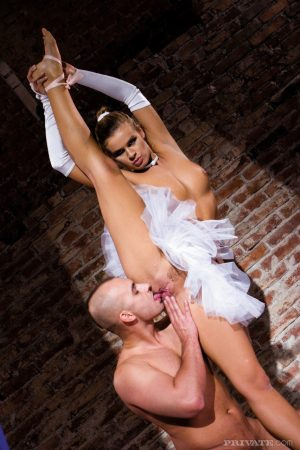 Flexible ballerina gets banged in a tutu and slippers by a large penis