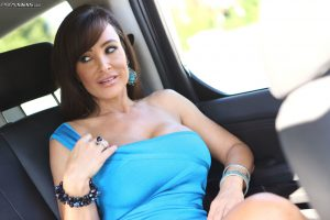 MILF babe Lisa Ann gets horny and rubs her tight slit in the car