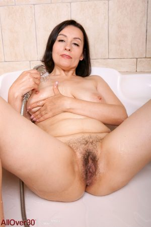 Horny mom with saggy boobs Allegra rubs her bushy twat while showering