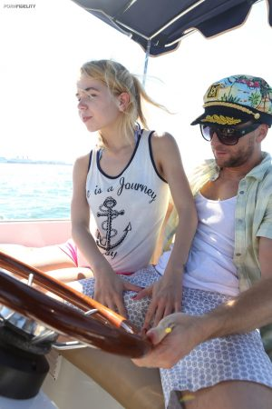 Petite teen Alina West deepthroats the captain before on-board doggystyle