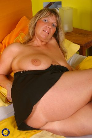 Mature European Tracy exposes saggy tits and fingers her juicy twat in solo