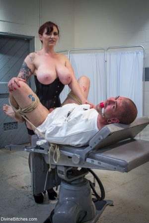Busty redhead MILF Mz Berlin abuses her sex slave's dick on the table