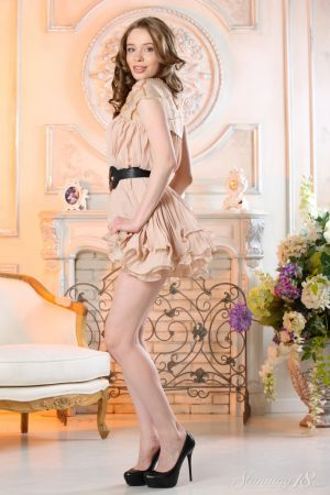 Sweet teen Britney A stands naked after removing a dress and high heels