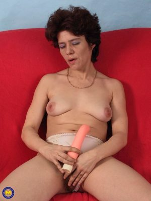Mature brunette Carmen toys her hairy vagina and gives a sloppy blowjob