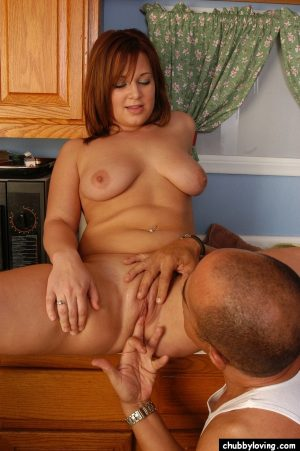 Redheaded plumper with small saggy tits giving blowjob in kicthen