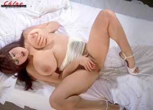 Sexy Euro redhead Chloe Vevrier shows off her massive all natural breasts
