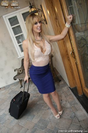 Sexy blonde sucks off a whole bunch of big black dicks at the same time
