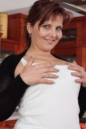 Redheaded Czech housewife Marie Jeanne masturbates with a cucumber