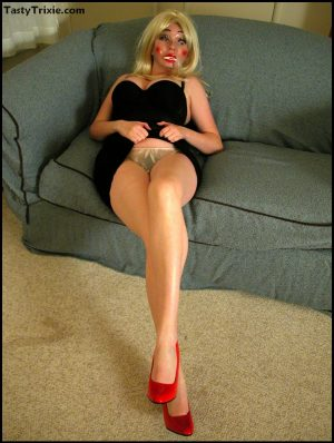 Leggy amateur Tasty Trixie wears a mask while baring her big tits and ass
