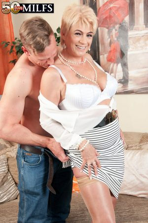 Mature blonde Dimonty wears her hair short during sexual intercourse