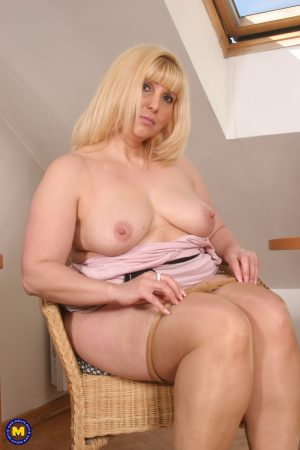 Voluptuous mature wife Tashia undresses and rubs her fat shaved pussy