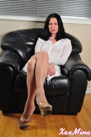 Dark haired amateur Mina Gorey models non nude in flesh colored stockings