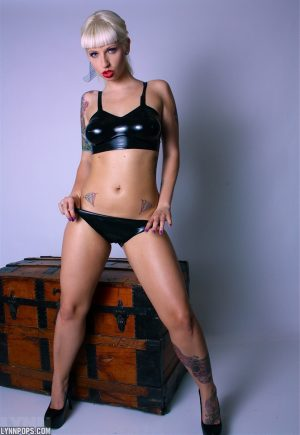 Tattooed amateur Lynn Pops takes off her latex bra and panty ensemble