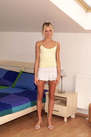 Skinny blonde teen Faith gaping her tight shaved pussy with a speculum