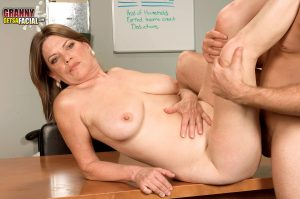 Brunette Granny Randi Layne gets cum on her face after an office blowjob