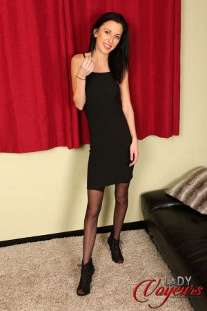 Skinny Ella Rose gives an upskirt to show her blue panties in stockings