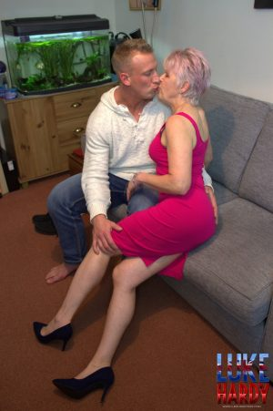 Mature granny in a pink dress Lady Sextacy gives an amazing blowjob to a stud