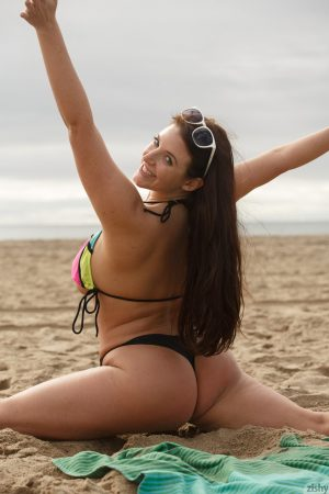 Australian stunner Angela White reveals and measures her big tits on the beach