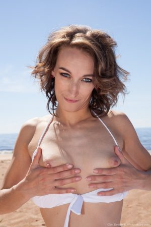 Hairy brunette with meaty lips Cleo Dream undresses & mastrubates at the beach