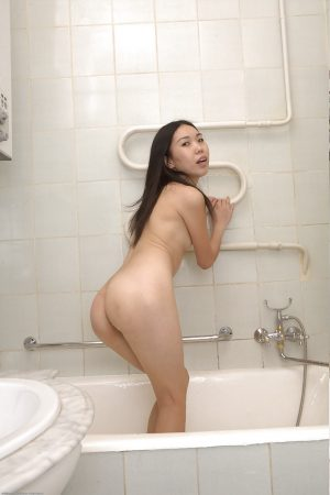 Smiley asian amateur exposing her skinny curves and teasing her slit