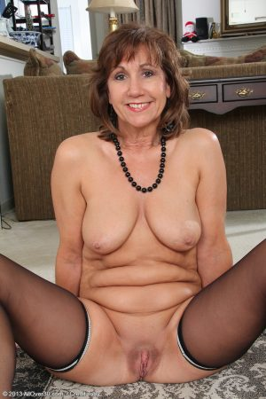 Mature wife Lynn showing off her saggy boobs & spread ass in black stockings 1