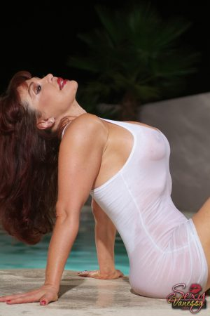 Redhead mature in a wet dress Sexy Vanessa flaunts her cleavage in the pool