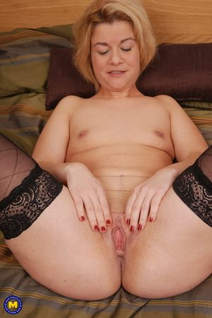 Tiny titted MILF Aranka V removes her dress & fingers pussy & ass roughly