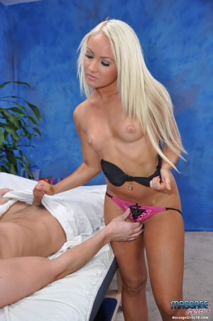 18 year old blonde parks her shaved vagina atop a cock on massage table