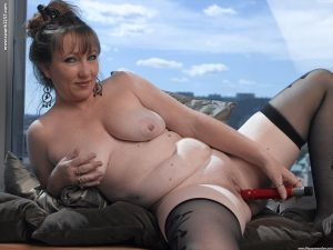 Older MILF on the plump side of the scales masturbates in sheer stockings