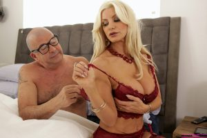 Big titted blonde Brittany Andrews seduces her stepson in stockings and heels