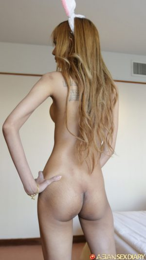 Slim Asian girl with long red hair and a hairy muff gets banged POV style