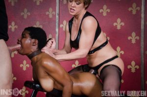 Black female Kahlista Stonem endures being mouth fucked by a strapon lesbian