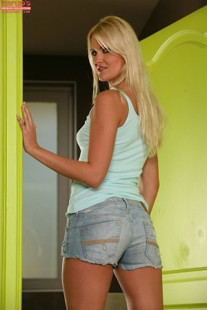 Blonde amateur Andrea Parker gets naked with her thong around her thighs