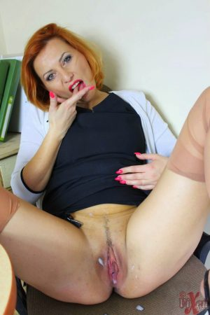 Redhead MILF Vixen Nylons removes her panties in the office for a pussy cream