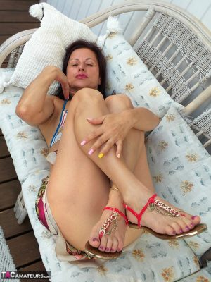 Middle aged amateur Diana Ananta displays her landing strip pussy on deck