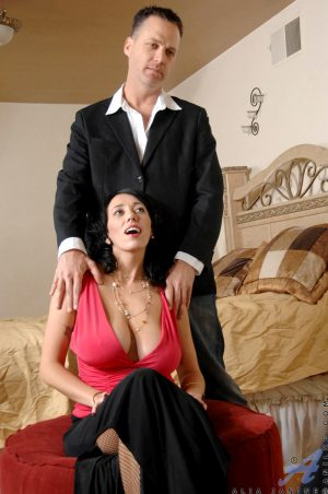 Dark haired cougar Alia Janine holds her big tits for jizz from toy boy