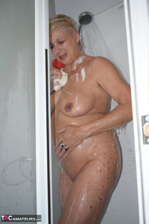 Mature blonde Dimonty gets caught naked while taking a shower