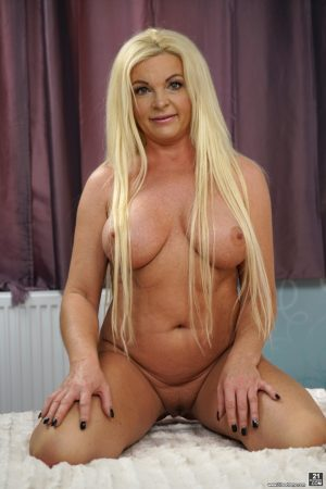 Curvy blonde granny named Franny showing her big natural titties