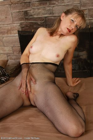 Mature housewife Lexa Mayfair peels to flaunt shaved pussy in sheer pantyhose