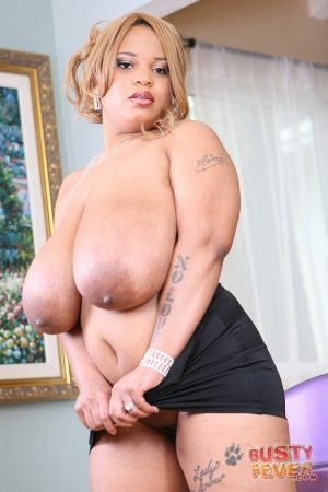 Slutty blonde with huge natural boobs sucks and rides fat black dick