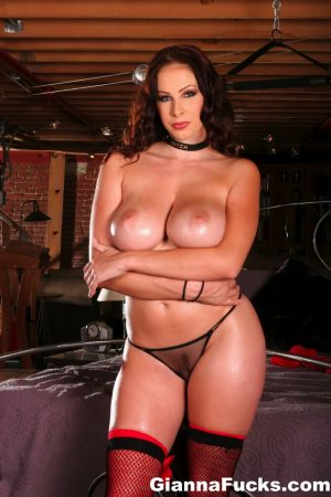 Sexy MILF Gianna Michaels wears a black choker while flaunting her nice boobs