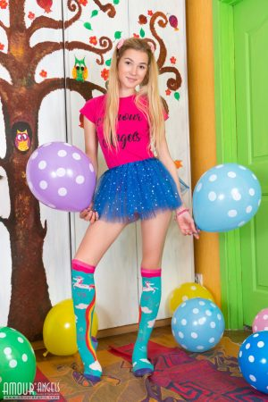 Young looking girl sports a no panty upskirt before getting nude amid balloons