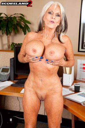 Hot blonde secretary Sally D'Angelo shows her huge breasts and fantastic body