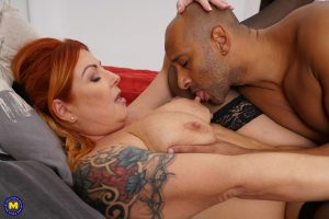 Redhead housewife with tattoos awaits the arrival of her black lover