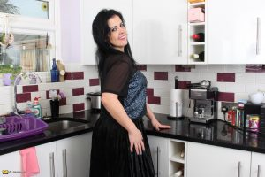 Dark haired housewife with big ass model topless in her kitchen