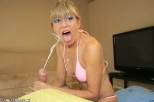 Hot granny Mrs Sexton gets cum on glasses by tugging on a hard cock