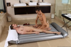 Asian masseuse Arial Rose rides cock and enjoys it in doggystyle position